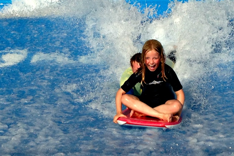 Royal Caribbean family cruises have a Flowrider continuous wave for surfing fun
